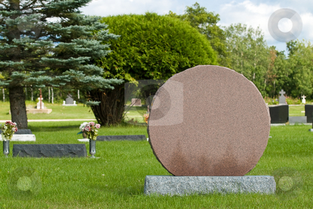 Blank Head Stone stock photo, A blank headstone in a cemetery or graveyard allowing the designer to put what they want on it. by Richard Nelson