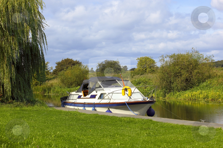 Pleasure boat stock photo, A pleasure boat on a canal waterway in summer by Mike Smith