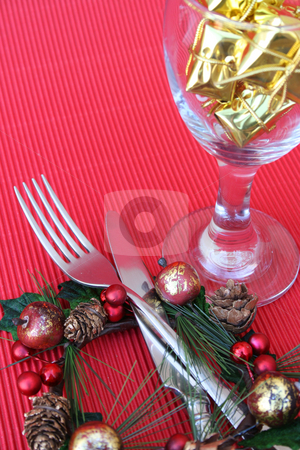 Christmas Setting stock photo, Christmas Table setting with cutlery, wine glass and wreath by Vanessa Van Rensburg