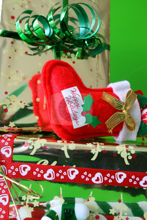 Stocking lying down stock photo, Christmas gifts with a miniature stocking lying ontop of it by Vanessa Van Rensburg