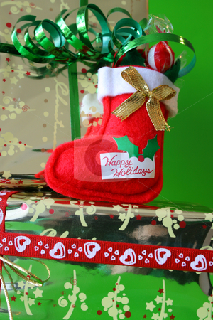 Stockings stock photo, Miniature Christmas Stocking on a gold wrapped gift by Vanessa Van Rensburg