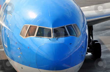 Passenger airplane nose stock photo, Air transportation: Close-up of a passenger airliner approaching the gate. by Fernando Barozza