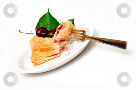 Fruit Turnover stock photo, Cherry filled flakey turnover on a white plate with fresh cherries on the side. by Lynn Bendickson