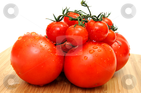 Large And Small Tomato stock photo, Cherry and large tomatoes washed and ready for a salad or sandwich. by Lynn Bendickson