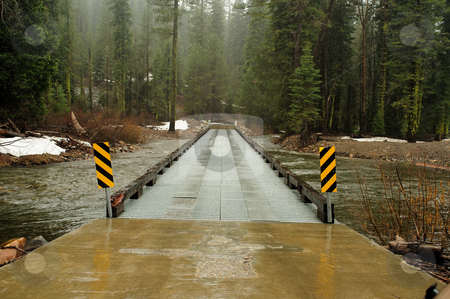 Forest River Crossing stock photo, Steel constructed bridge provides a crossing over a small river in the El Dorado National forest by Lynn Bendickson