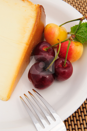 Cherries And Cheese Cake stock photo, Ranier and Bing cherry on a white plate withe a slice of plain cheese cake. by Lynn Bendickson