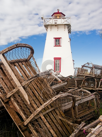 Lighthouse and Lobster Traps, North Rustico, PEI stock photo, Old lobster pots surround the North Rustico Lighthouse, Prince Edward Island, Canada by Kenneth Keifer