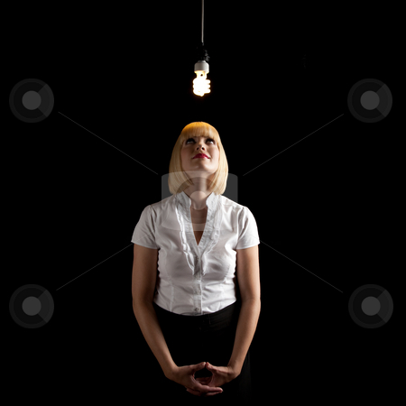 Beautiful Blonde with Light Fixture stock photo, A beautiful blonde standing in a dark room and glancing up at hanging light fixture.  Square framed shot. by Media Deva