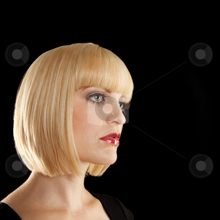 Beautiful Blonde Staring stock photo, The profile of a beautiful blonde. She has a contemplative expression on her face. Square framed photo. by Media Deva