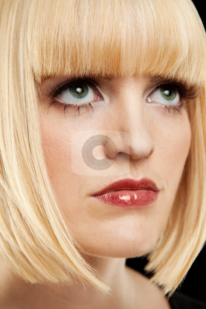 Beautiful Blonde Headshot stock photo, The headshot of a beautiful blonde woman.  She is looking upward and has a contemplative expression on her face.  Vertically framed shot. by Media Deva