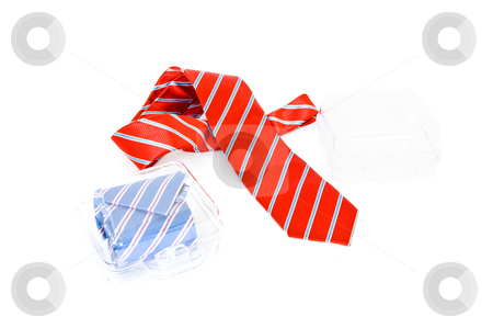 Neckties and gift boxes stock photo, Two neckties, one in a gift box, one casually draped besides an empty case by Corepics VOF