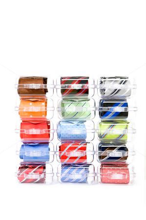 Neckties in gift boxes stock photo, Fifteen assorted neckties in various colors in gift boxes, stacked on display against a white background by Corepics VOF