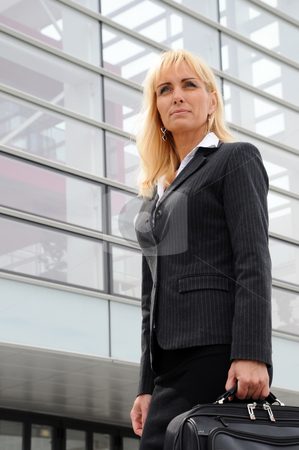 Business Outside 3 stock photo, Business woman standing in front of office building. by Tony Lott N??rnberger