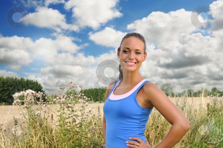 Girl in Crop field stock photo, Young woman in crop field by Tony Lott N??rnberger
