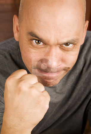 Man making a fist stock photo, Angry man with shaved head making a fist by Scott Griessel