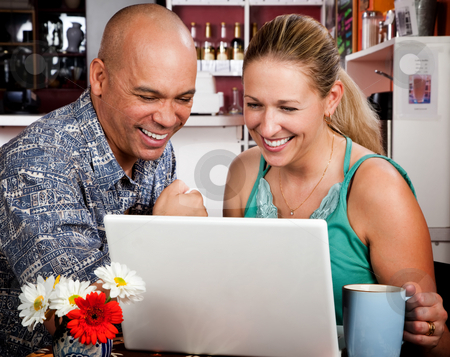 Couple in Coffee House with Laptop Computer stock photo, Adult couple in coffee house with laptop computer by Scott Griessel