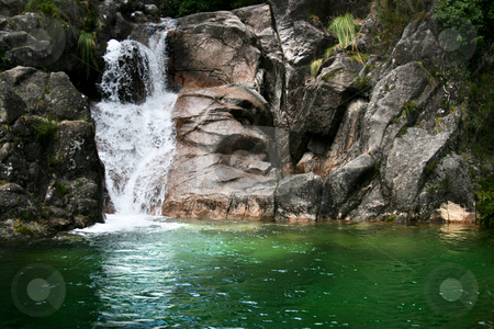 Waterfall stock photo, Hiden waterfall on a mountain river with a little green lake. by Marc Torrell