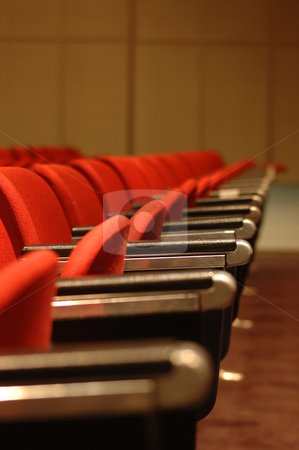 Red Theatre Seats stock photo, A line of red theatre seats - shallow depth of field by Lee Torrens