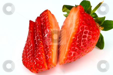 Cutted strawberry stock photo, Fresh ripe strawberry cutted into pieces on white background by Oleg Karpenko