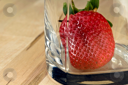 Strawberry in the glass stock photo, Big fresh strawberry in the whiskey glass on wood table by Oleg Karpenko