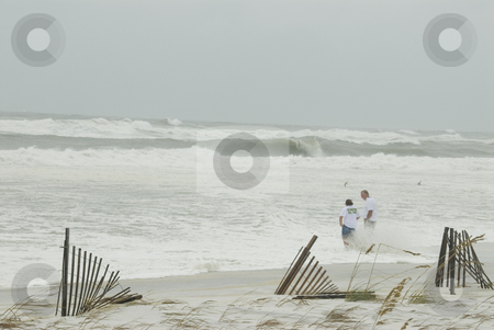 High Gustav Surf stock photo, PENSACOLA - SEP 1: The incoming surf hits a couple standing far above the high tide line during Hurricane Gustav on September 1, 2008. Gustav generated a storm surge of 15 feet. by A Cotton Photo