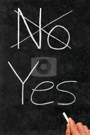 Crossing out No and writing Yes on a blackboard. stock photo, Crossing out No and writing Yes on a blackboard. by Stephen Rees