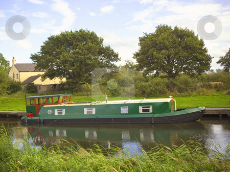 Green narrow boat stock photo, A green narrow boat on a waterway in summer by Mike Smith