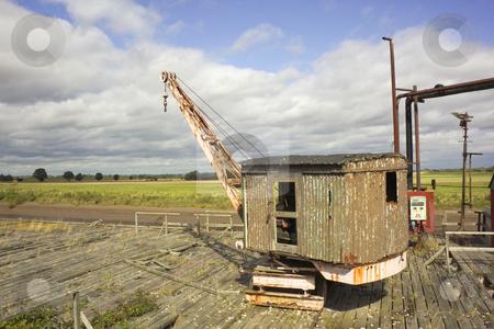 Riverside wharfe stock photo, A small hoist on an abandoned riverside wharfe by Mike Smith