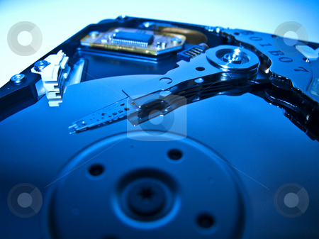 Computer Hard Drive - Cold Blue stock photo, A computer hard drive closeup shot in blue for cold blue technology by Stephen Clarke