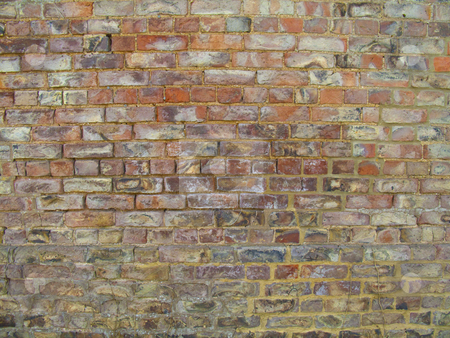 Brick Wall stock photo, An closeup of an old and weathered brick wall by Stephen Clarke