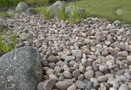 Pebbles and a rockery stock photo,  by Stephen Clarke