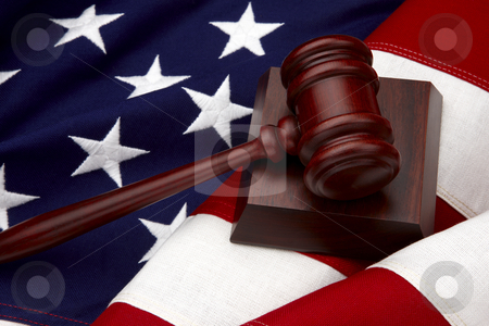 Gavel and American Flag still life stock photo, Close up shot of wooden gavel shot on American flag by James Barber