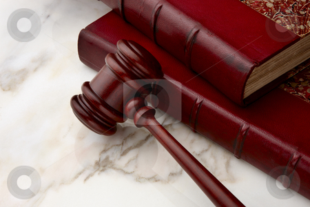 Legal still life stock photo, Gavel and law books shot on marble surface by James Barber