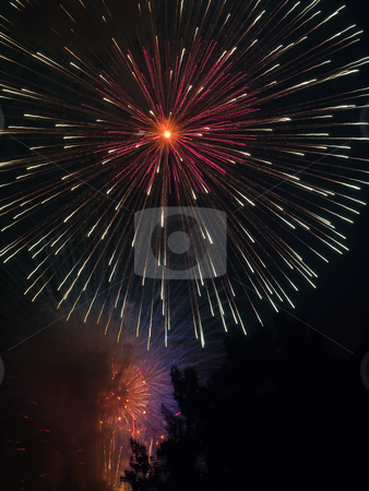 Huge Fireworks Explosion stock photo, A large fireworks shell explodes in a colorful flower at a celebration. by Kenneth Keifer