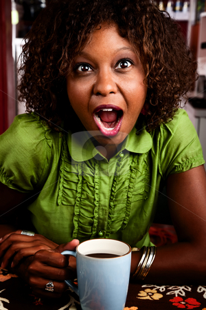 Pretty African American Woman with Shocked Expression stock photo, Pretty African American woman with shocked expression on her face by Scott Griessel