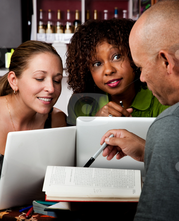Diverse adult study group stock photo, Diverse adult study group in coffee house by Scott Griessel