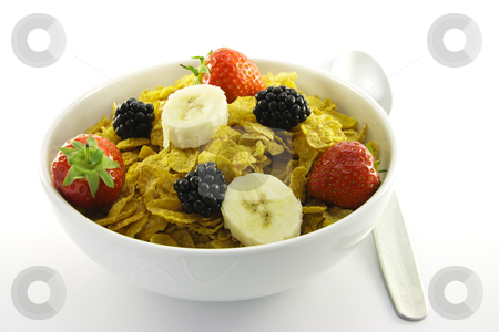 Cornflakes and Fruit in a White Bowl with Spoon stock photo, Cornflakes with strawberries, blackberries and banana in a round white bowl with a spoon on a white background by Keith Wilson