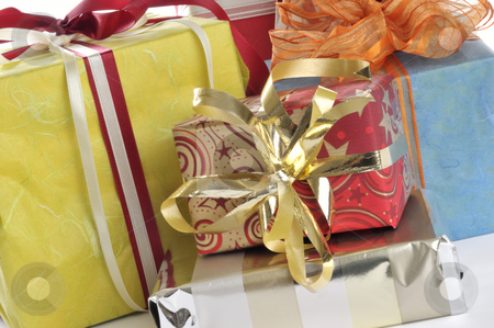 Gifts stock photo, Colorful christmas gifts in front of a white background by Carmen Steiner