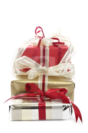 Three christmas packages stock photo, Three christmas packages in front of a white background by Carmen Steiner