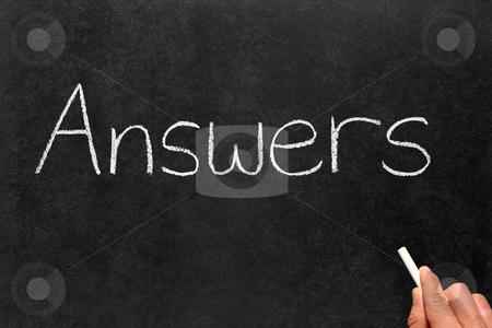 Writing answers on a blackboard. stock photo, Writing answers on a blackboard. by Stephen Rees
