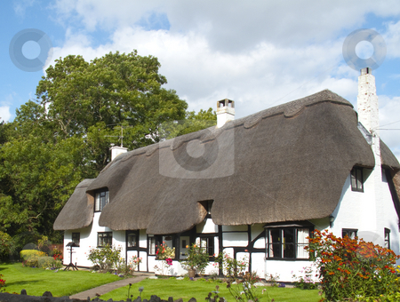 Thatched Cottage stock photo, A lovely picture postcard thatched white cottage by Stephen Clarke