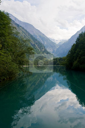 Mountain lake stock photo, Mountain lake in Austria surrounded with trees and mountains by Karin Claus