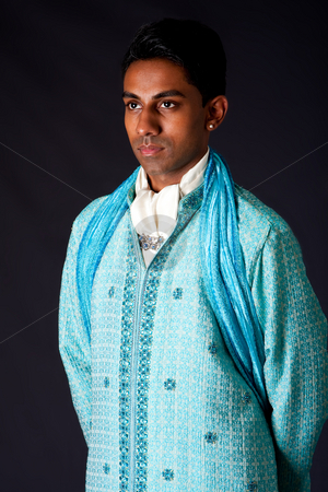 Hindu groom wearing a Dhoti stock photo, Beautiful authentic Indian hindu man in typical ethnic groom attire. Bangali male wearing a light blue agua decorated Dhoti with shawl. by Paul Hakimata