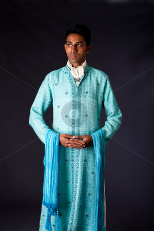 Indian groom wearing a Dhoti stock photo, Beautiful authentic Indian hindu man in typical ethnic groom attire standing with hands together. Bangali male wearing a light blue agua decorated Dhoti with shawl. by Paul Hakimata