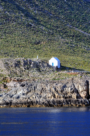 Greek chapel on the south shore of Crete stock photo, Travel photography: Isolated white Greek chapel by the sea by Fernando Barozza