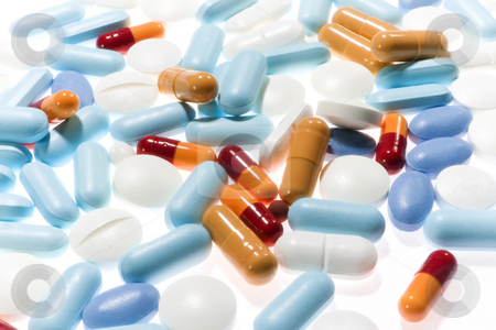 Prescription drugs stock photo, Stock image of backlit prescription drugs, pills, capsules and tablets of different colors all mixed in. Focus on center. by iodrakon