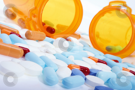 Prescription drugs stock photo, Stock image of pills, capsules and tablets of different colors over white. by iodrakon