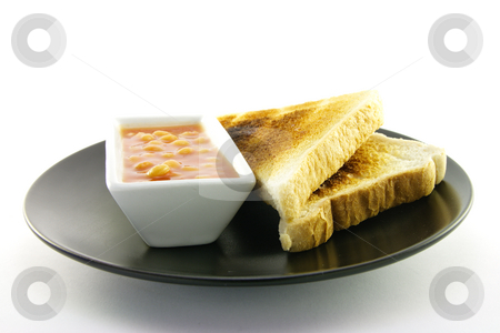 Cooked Breakfast Items on a Plate stock photo, Delicious cooked breakfast items with toast and baked beans on a plate on a white background by Keith Wilson