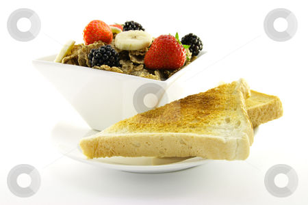 Bran Flakes in a White Bowl stock photo, Crunchy looking delicious bran flakes and juicy fruit in a white bowl with toast on a white background by Keith Wilson