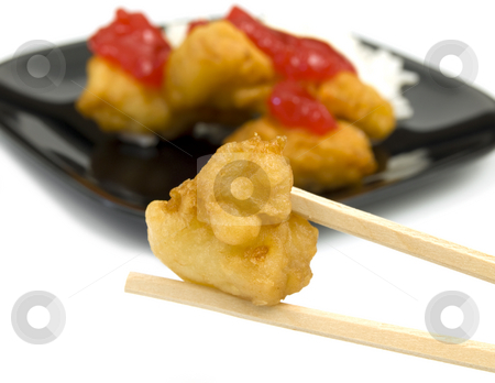 Chop sticks with chicken stock photo, Chop Sticks with Chicken on white background by John Teeter